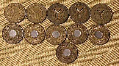 11 Various New York City Subway tokens