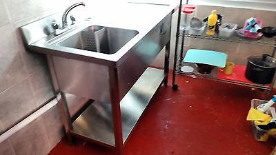 stainless steel sink with taps and hot water system