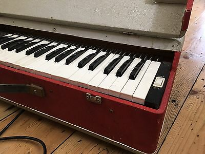 Keyboard. Piano. Electric. Portable. Vintage.