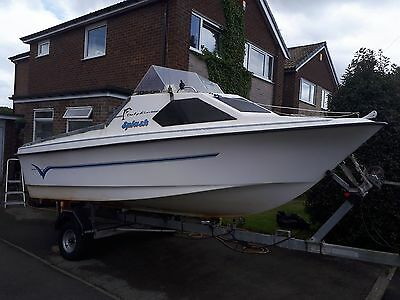Dolphin 16ft cabin cruiser sea / river boat with 60hp evinrude outboard