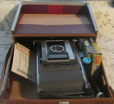 Vintage Polaroid Land Camera Model J66 with Case Flash Bulbs and more