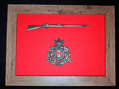 24th Regiment of Foot Zulu War Helmet Plate and 1/6 scale Martini-Henry Rifle