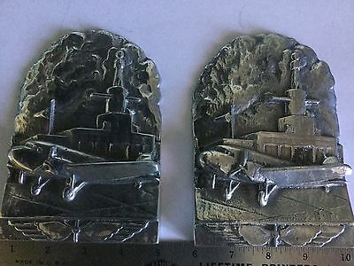 "2 aluminum book ends 4""x6"" tall with DC3 pictured at a airport"