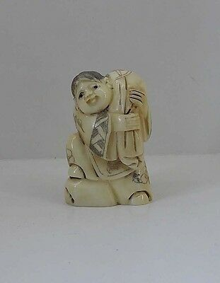 Japan Solid Bone Carving boy carrying a package Statue Hand Carved Netsuke