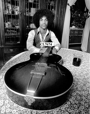 Prince Rogers Nelson with His Guitar at Home Photo
