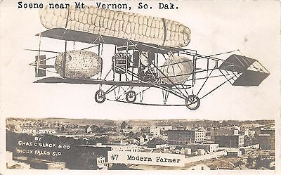 Mount Vernon-Mitchell South Dakota~Farmer in Airplane~Exaggerated Produce~RPPC