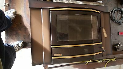 wood fire place heater coonara slow comustion with fan inc flu
