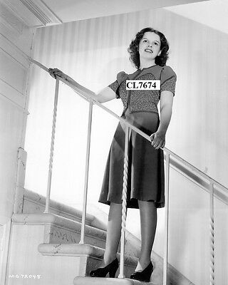 Judy Garland Poses for a Portrait on the Stairs Photo