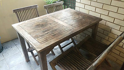 4 seater outdoor teak table with 4 folding chairs