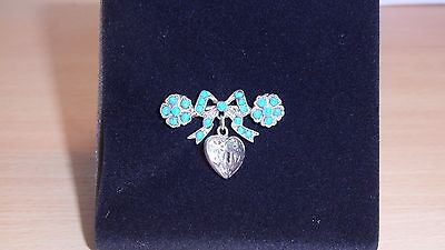 Silver bow, flower and heart brooch