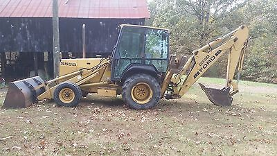 1997 Ford 555D Backhoe with Enclosed cab