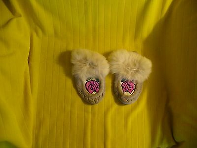 Cree Caribou Hide Hand Made moccasine, With Beaded Flowers on Front.