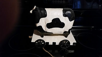 cow decoration on wheels