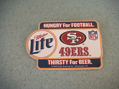 SF 49er plastic pin from 1999 sponsored by Miller Lite beer