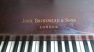 Piano with steel frame, candle fitting points with antique features in dark wood