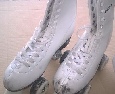 White size 5 Roller Skates and small selection spares