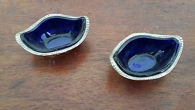 Victorian salt and mustard pots with blue glass inserts.