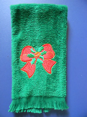 Fingertip towel red bow applique on green velour with fringe ends