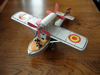 Tin model toy aeroplane colletable all working part wind up with box Spainish