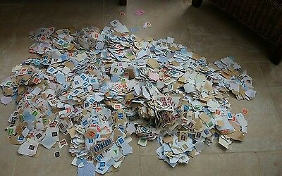 Literally hundreds of postage stamps mainly on paper. Over 3kg. ideal decoupage