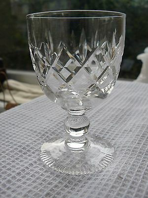 Cut glass ball stem wine glass with decorated base edge. 10cm tall