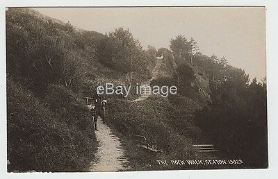 Seaton - The Rock Walk with family near steps (Chapman) RP postcard Devon