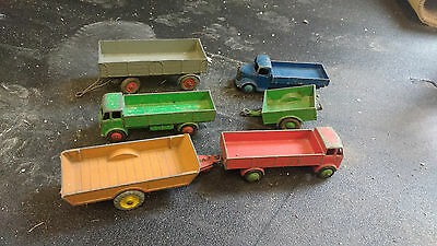 Collection of Dinky Toys trailer trucks in varying conditions