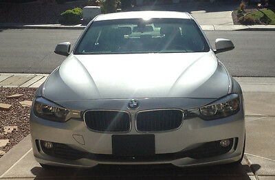 2014 BMW 3-Series 320i 320i 4dr Sedan (2.0L 4cyl Turbo 8A) Featuring Black Leather Interior