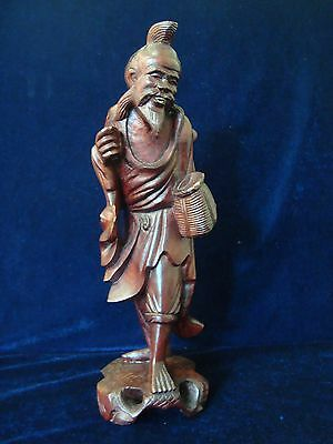 A Vintage Chinese Carved Wood Figure Of A Fisherman.