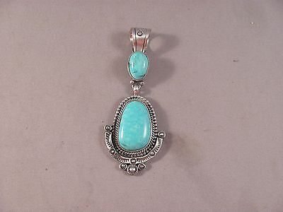 Navajo Stabilized Turquoise and Silver Pendant by Ray Dalgorito