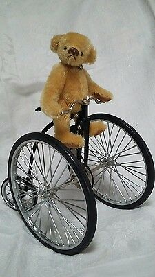 mohair bear on a bike