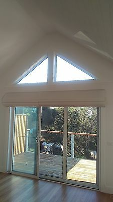 """""""Next to new""""  8 Light Filtering White Roman Blinds. Will sell individually."""