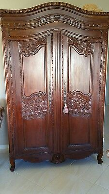 French Country style carved armoire