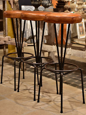 Pair of mid-century French barstools with leather seats