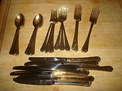new gold set flatware by c. wallace 8 ea salad fork ,dinner fork,spoon & knife