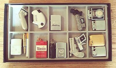 lot of vintage lighters in excellent condition with nice display case