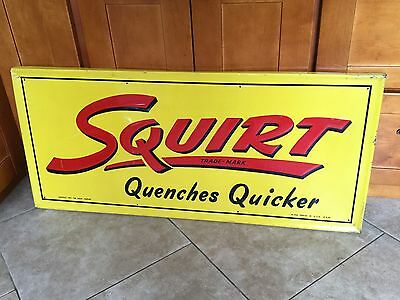 1947 Squirt Quenches Quicker Embossed Tin Enameled Sign, Salvage Store Display
