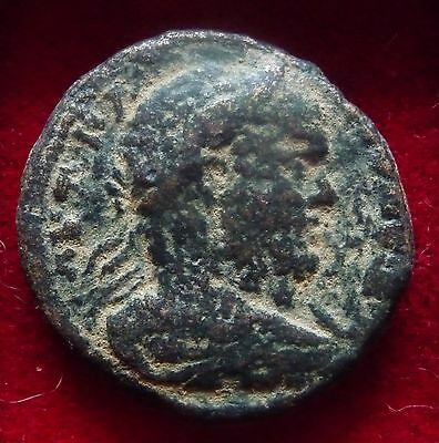 Decapolis, Gadara Caracalla AE27 tetrastyle temple Zeus seated Dated 215 AD