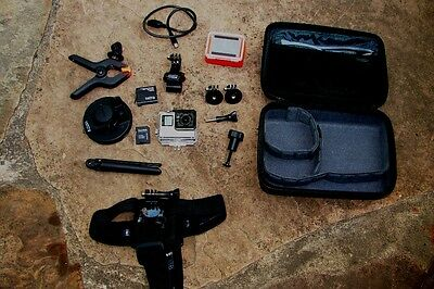 GoPro Hero Silver 4 camera with many accessories