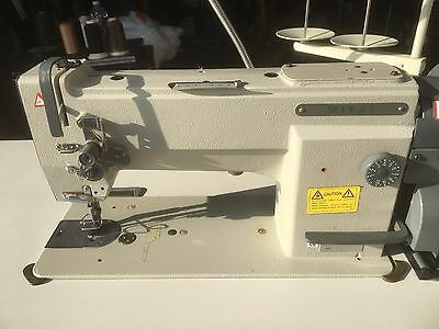 Mitzi Industrial Sewing Machine (Juki) Model YU360CTS with extra motor.