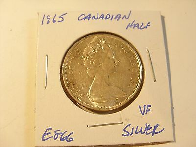 Very nice 1965 Canadian Silver Beauty Half Dollar Check out the pictures (E866)