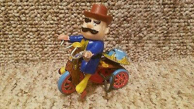 Vintage  marx tin windup  toy man on cycle