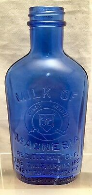 "ANTIQUE 7"" Glass Cobalt Blue Embossed Milk of Magnesia Medicine Bottle c1910"