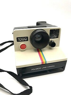 polaroid 1000 land camera uses sx 70 film for instant colour photo 39 s red button. Black Bedroom Furniture Sets. Home Design Ideas