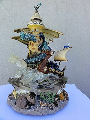 Dragon Wrapping Around A Lighthouse With Wizard - San Francisco Music Box