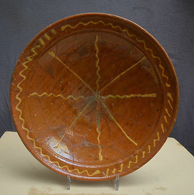 Nice large early 17th century Dutch slibware plate whit a star-line decor.