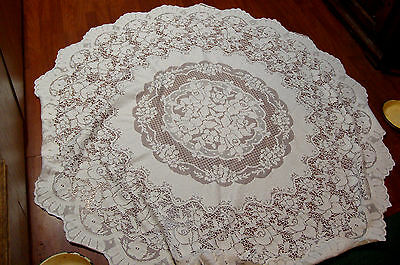 vintage lace tablecloth. Circular diameter 70 inches with gamask undercloth