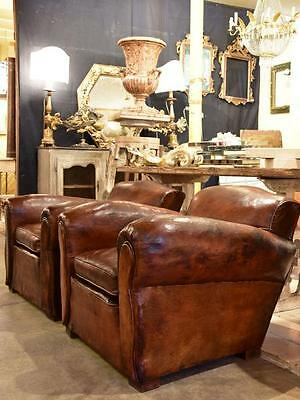 Pair of 1930's French vintage leather club chairs - chapeau gendarme back