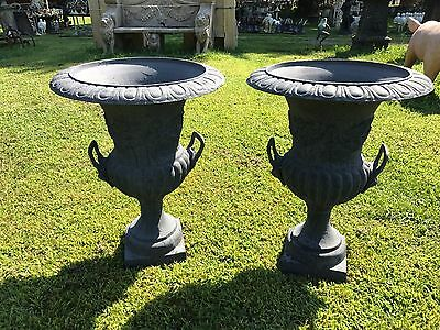urns or planter pair cast iron with lion headed handles