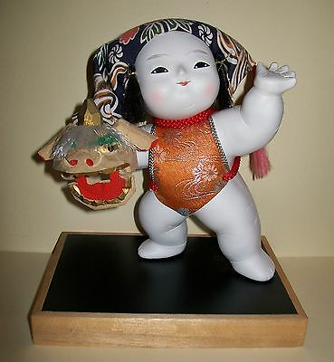 VINTAGE, CUTE JAPANESE DOLL holding dragon lantern (ceramic/fabric/wood)